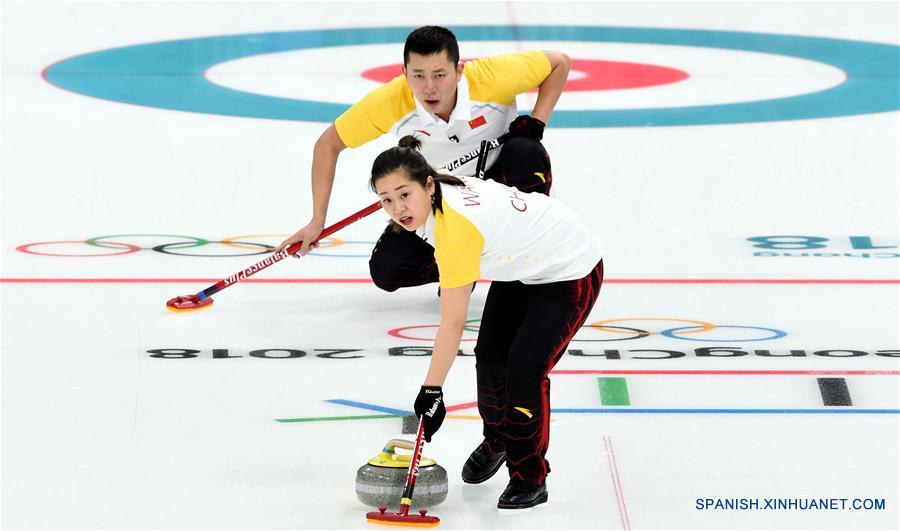 China vence a Finlandia en curling doble mixto in PyeongChang Games mixed doubles curling